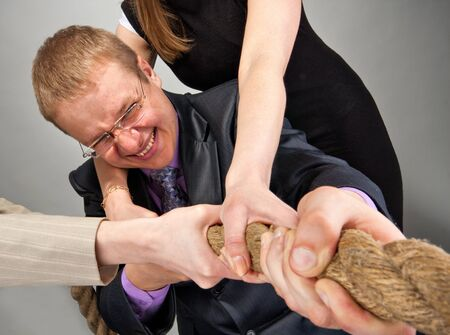 Portrait of business team pulling a rope Stock Photo - 18482404