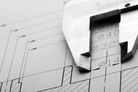 vernier caliper: Close-up of engineering drawing and caliper