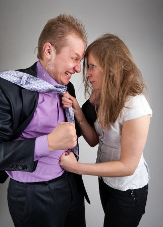 Business quarrel - Businessman and businesswoman punching each other photo