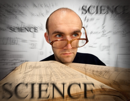 scientific literature: Pensive scientific mathematician with open book looking through time Stock Photo