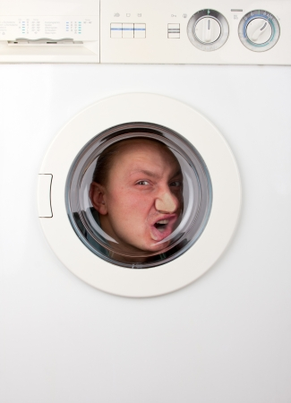 bizarre: Close-up of bizarre man inside washing machine