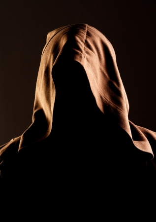 theology: Portrait of mystery unrecognizable monk in robe
