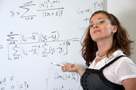 sexy teacher: Attractive mathematics teacher in classroom