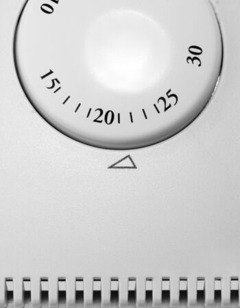 Close-up of room thermostat dial. In BW photo