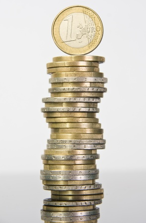 european union currency: Stack of euro coins with one euro on top