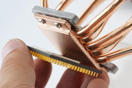 electronics industry: Engineer installing computer processor to big cooler