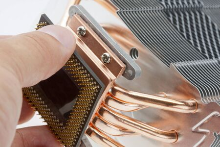 computer hardware: Engineer installing computer processor to big cooler