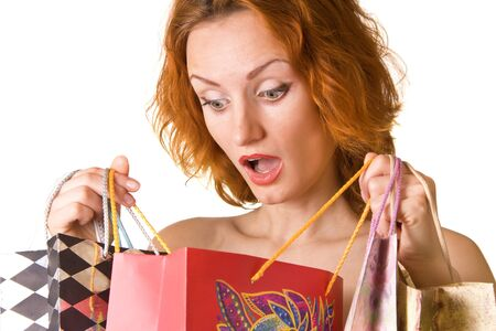 unexpected: Unexpected shopping. Surprised woman looking into the bag