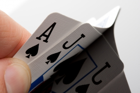 Close-up of blackjack cards in palm of hand