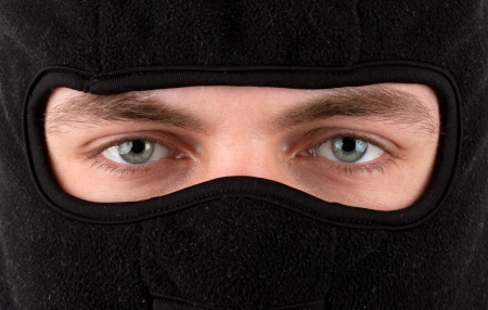 Close-up view of man in black balaclava photo