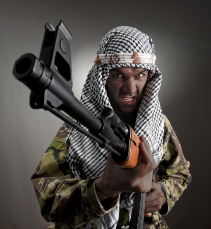 guerrilla warfare: Portrait of serious middle eastern man with AK-47