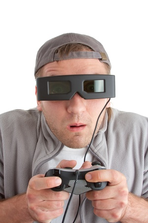 startled: Surprised player with joystick and 3-D glasses. Isolated on white