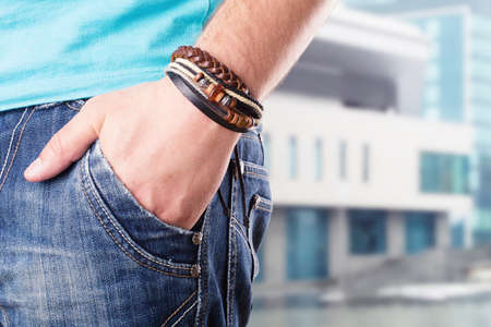 Closeup of a male standing with his hand in his pocket Stock Photo - 18550186