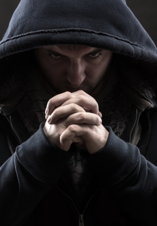 Despair bandit praying God for forgiveness photo