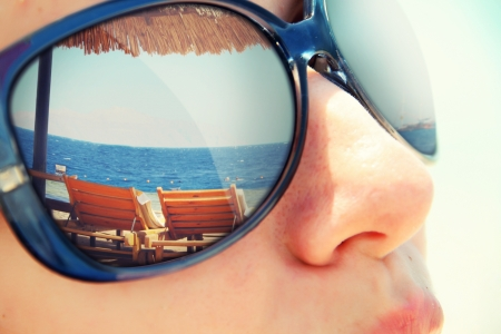 beach scene: Reflection of a tropical resort in sunglasses