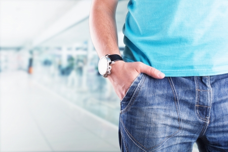Closeup of a male standing with his hand in his pocket Stock Photo - 18550188