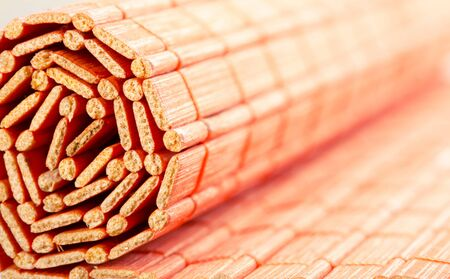 straw mat: Closeup of rolled bamboo mat