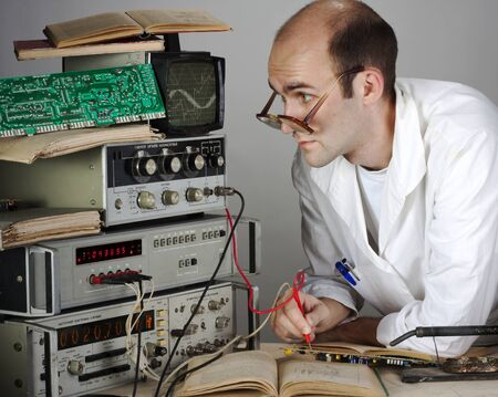 electronic book: Pensive scientist working at vintage technological laboratory Stock Photo