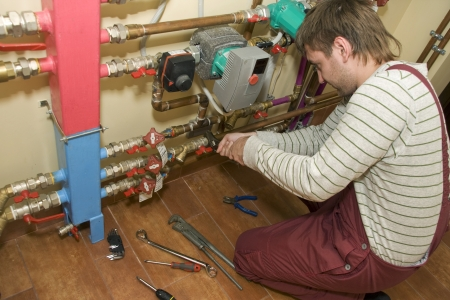 Service man at work. Servicing water & heating systems Stock Photo - 18560983