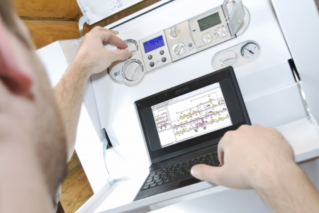 and heating: Technician at work. Servicing water & heating systems Stock Photo