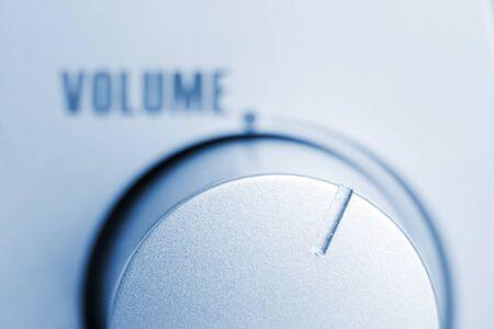 Close-up of loudspeaker volume regulator. Toned in blue photo