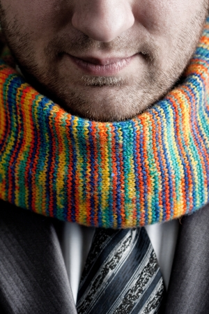 Businessman in formal grey suit and colorful scarf Stock Photo - 18560994