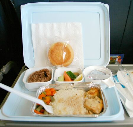 Rise and chicken. Classic airplane food photo