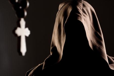 Portrait of mystery unrecognizable monk in robe photo