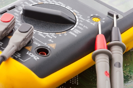 multimeter: Close-up of digital multimeter on electronics circuit Stock Photo