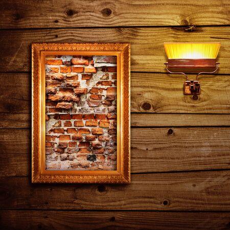 broken brick: Broken brick wall exposition on wooden wall Stock Photo