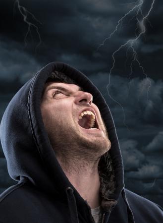Despair bandit screaming to dark sky photo