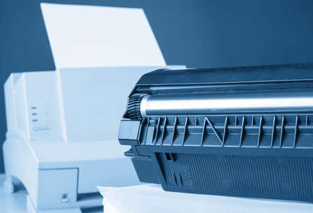 toner: Toner cartridge against laser printer  Toned in blue