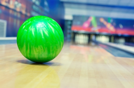 bowling ball: Ball on bowling alley against ten pins