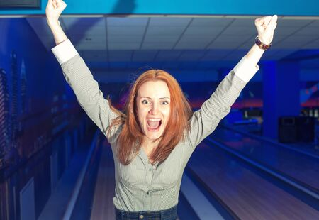 Portrait of excited girl in a bowling alley photo