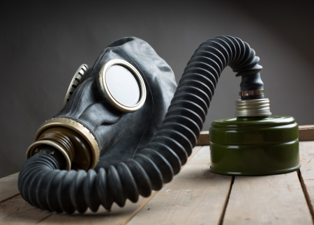 bizarre: Closeup of old gas mask on wooden box