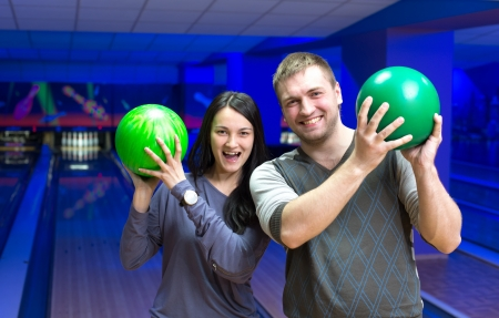 bowling alley: Happy couple in a bowling alley having fun