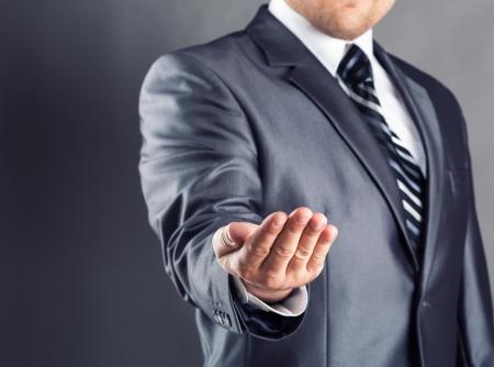 Unrecognizable businessman asking for bailout photo