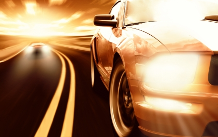 moving activity: Two sport cars racing on a narrow road Stock Photo