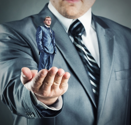 Hand giving small confident businessman Stock Photo - 18954734