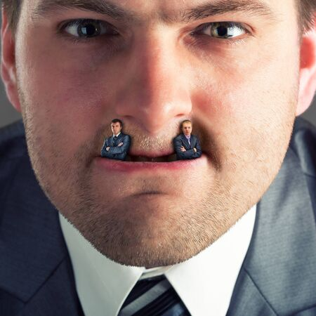 primal: Businessman predator - businessmen instead of fangs Stock Photo