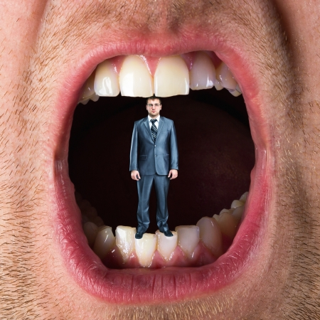Small businessman standing in open mouth photo
