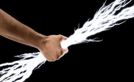 zeus: Male hand holding lightning bolts