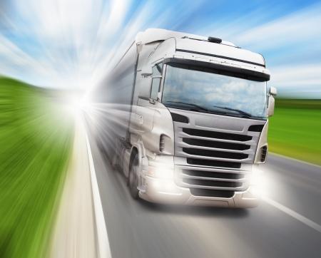 Cargo truck speeding on highway photo