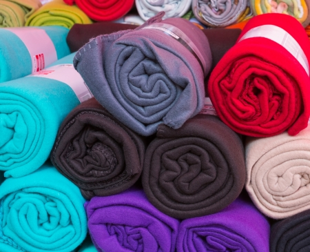 fleece: Many rolled colorful fleece blankets