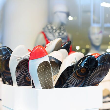 Casual female shoes on display photo