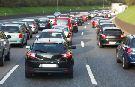 slowdown: Traffic jam on a freeway Stock Photo