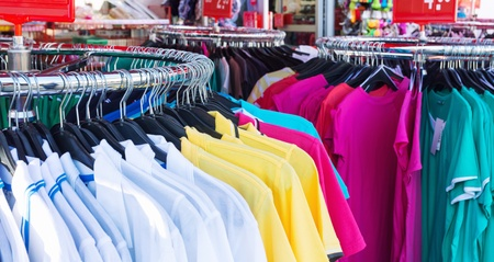 clothing shop: Colorful clothing on hangers in casual shop