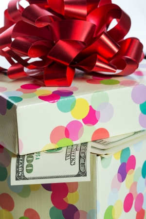 Gift box full of $100 dollar bills photo