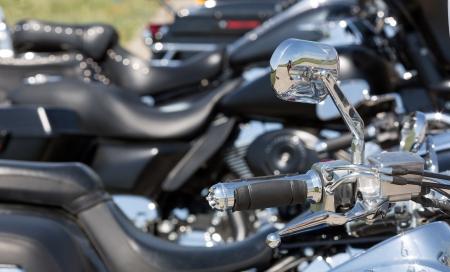 chromed: Closeup of chromed motorcycle handlebar