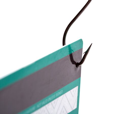 Closeup of a credit card caught on a fishing hook photo